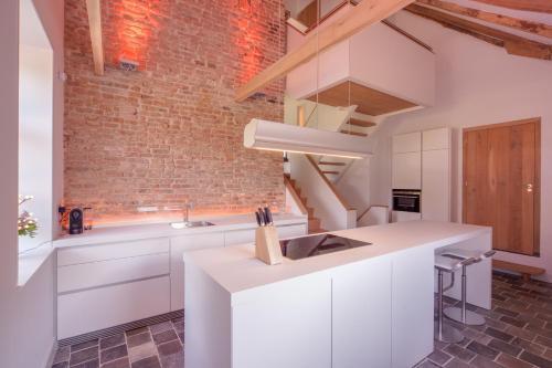 Een keuken of kitchenette bij Logies Groot Okhorst