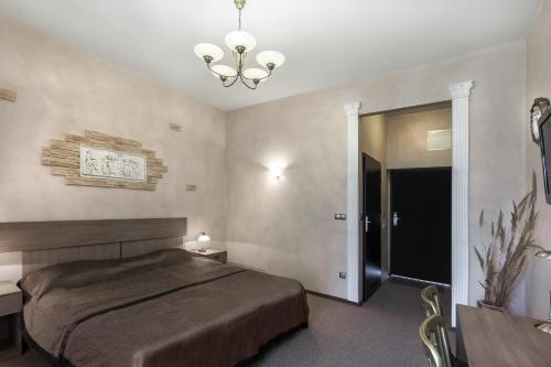 Кровать или кровати в номере Hotel Pałac Nieznanice