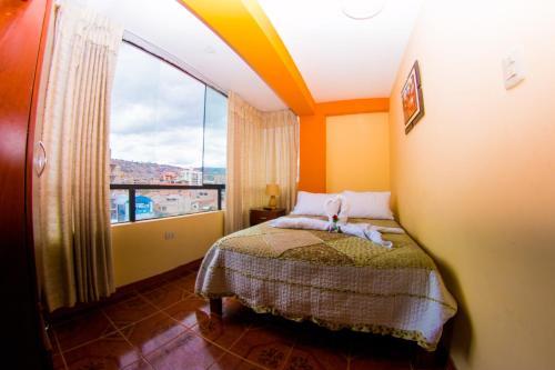 Cama o camas de una habitación en Yupanqui Apartments I