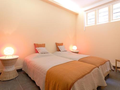 A bed or beds in a room at Feels Like Home Boavista House of Music with Private Garden