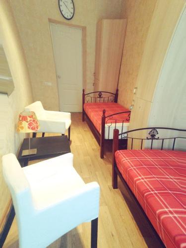 Кровать или кровати в номере Voskhod