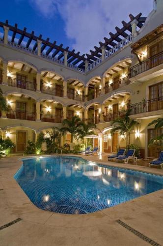 The swimming pool at or near Hacienda Real del Caribe Hotel