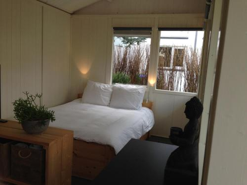 Un ou plusieurs lits dans un hébergement de l'établissement Madame Jeanette