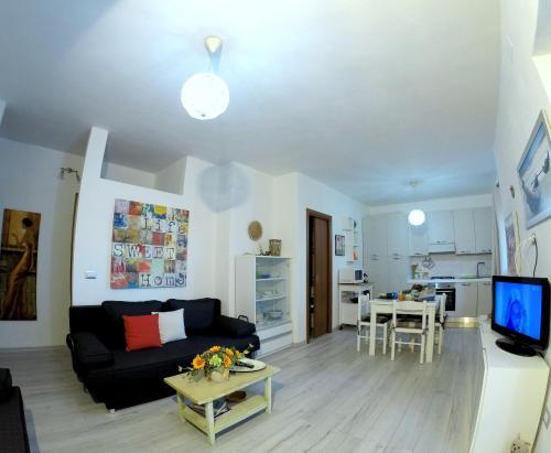 A seating area at Appartamento in villa