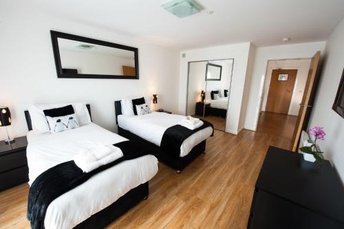 A bed or beds in a room at Westport Serviced Apartments