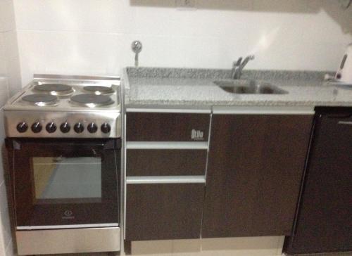 A kitchen or kitchenette at Apart Los Vascos