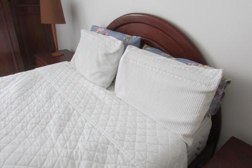 A bed or beds in a room at Urquiza 235