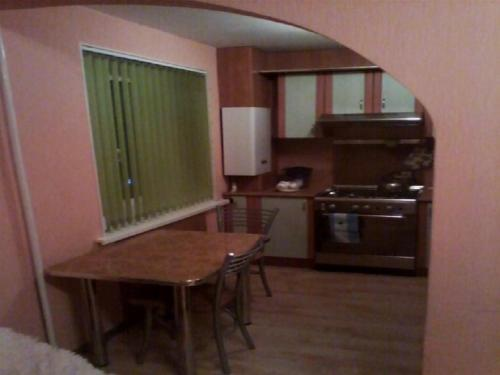 Кухня или мини-кухня в Apartment On Germana
