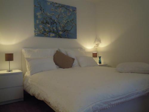 Un ou plusieurs lits dans un hébergement de l'établissement Appartement Seabird