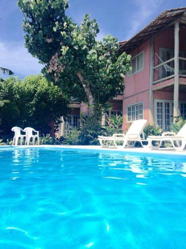 The swimming pool at or near Musa de Maresias
