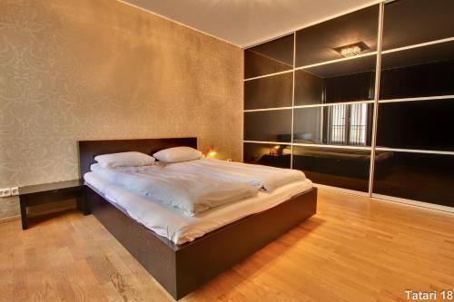 Voodi või voodid majutusasutuse Daily Apartments - Freedom Square toas