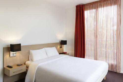 Voodi või voodid majutusasutuse Aparthotel Adagio Access Saint Louis Bâle toas