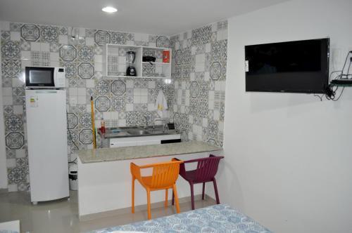 A cozinha ou cozinha compacta de Suites Cheiro do Mar