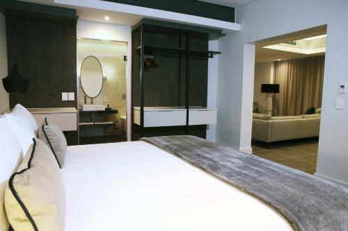 A bed or beds in a room at The Capital Mirage Hotel