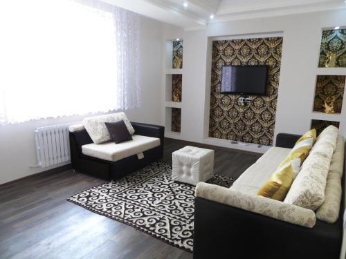 Coin salon dans l'établissement Bishkek House Apartament