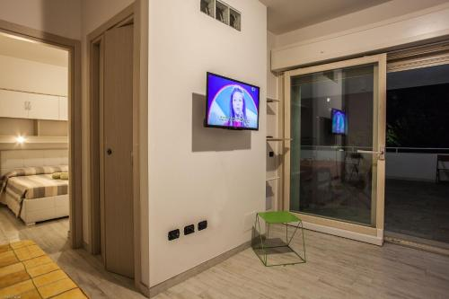 A television and/or entertainment center at Residences del teatro