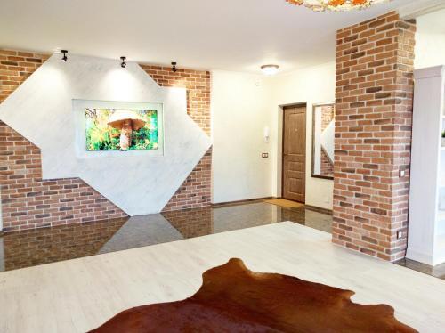 A bed or beds in a room at Loft Apartments Platonova 33