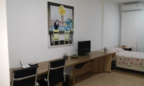 Una televisión o centro de entretenimiento en Studio no Centro de Florianópolis