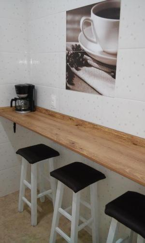 Una cocina o zona de cocina en Studio no Centro de Florianópolis