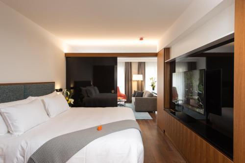 Cama ou camas em um quarto em Fraser Suites Geneva - Serviced Apartments