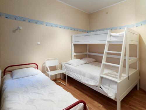 Een stapelbed of stapelbedden in een kamer bij Residentie Kursaal