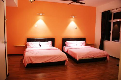 A bed or beds in a room at Shamrock Seaview 11 Villa