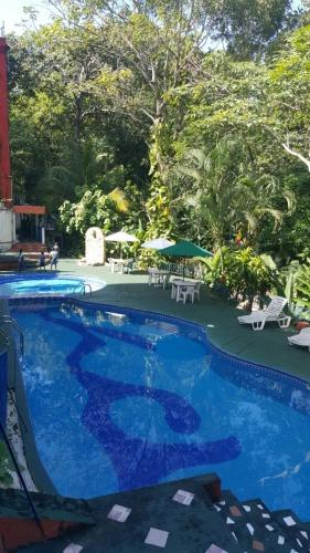 The swimming pool at or near Hotel Quinta Avenida
