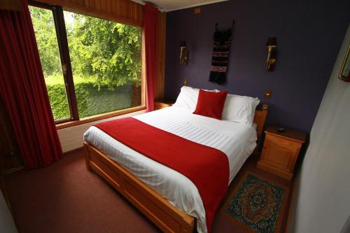 Cama o camas de una habitación en Cabañas de Turismo Araucarias del Sur