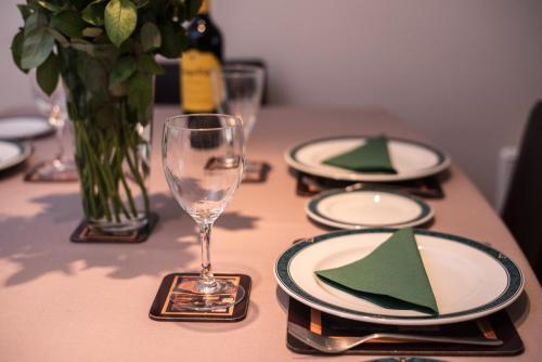 A restaurant or other place to eat at Central Brighton Apartment with Private Parking