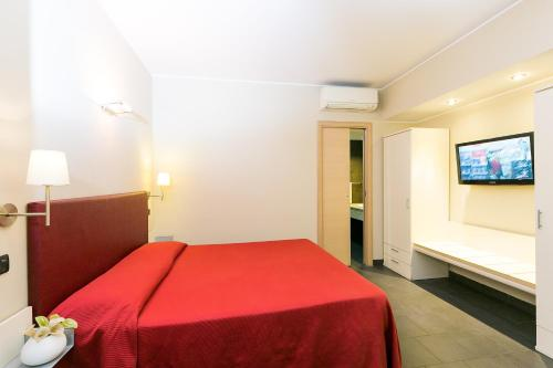 A bed or beds in a room at Hotel Residenza Gra 21