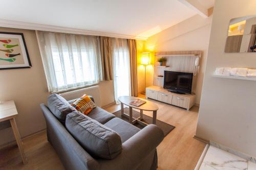 Гостиная зона в Garan Apartments