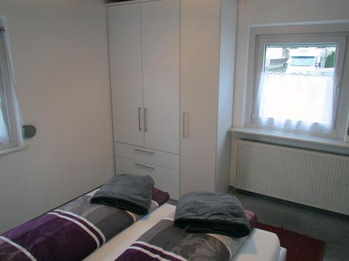 Ein Bett oder Betten in einem Zimmer der Unterkunft Apartment Ursula
