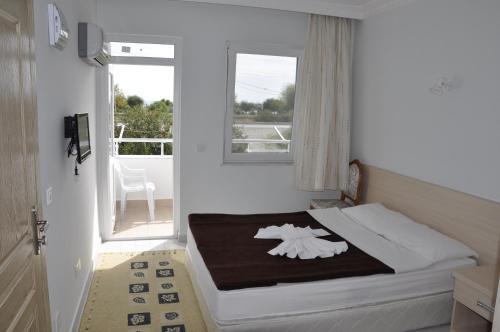Lova arba lovos apgyvendinimo įstaigoje Hotel Anadolu