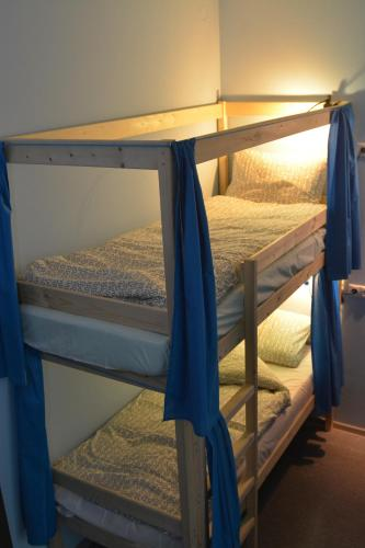 A bunk bed or bunk beds in a room at Tsiolkovsky on VDNKh