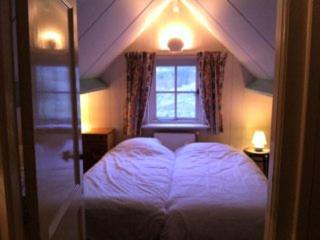 Ein Bett oder Betten in einem Zimmer der Unterkunft Dune Bep