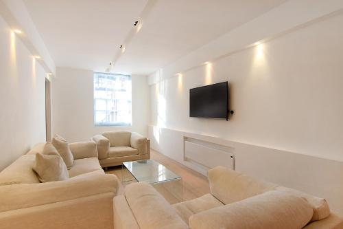 Uma área de estar em London Lifestyle Apartments – Knightsbridge – Hyde Park