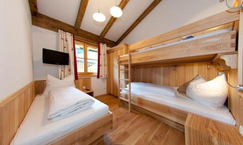 A bunk bed or bunk beds in a room at Tauernchalets