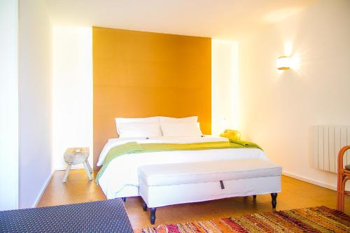 A bed or beds in a room at Liiiving in Porto | Oporto Garden Pool House