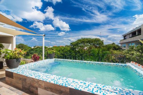 The swimming pool at or near Suites Corazon