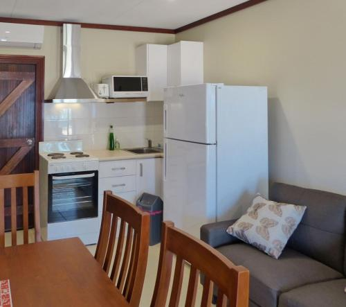 A kitchen or kitchenette at The Cocos Padang Lodge