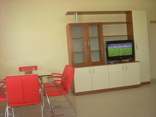 A television and/or entertainment center at Mellieha Centre Apartments