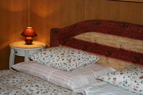 A bed or beds in a room at Zderaz