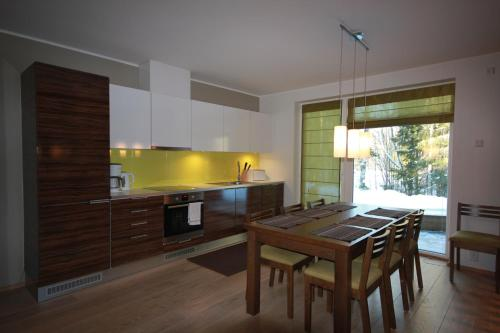 A kitchen or kitchenette at Marina Holiday Honka Village
