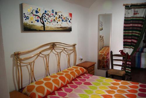 A bed or beds in a room at Cuevas de María