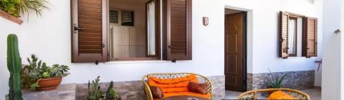 A seating area at Holiday home Diaz Buggerru