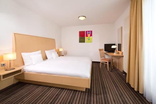 Кровать или кровати в номере HSH Hotel Apartments Mitte