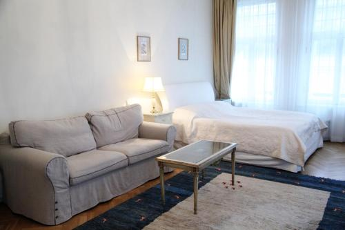 A bed or beds in a room at Apartments - Laipu