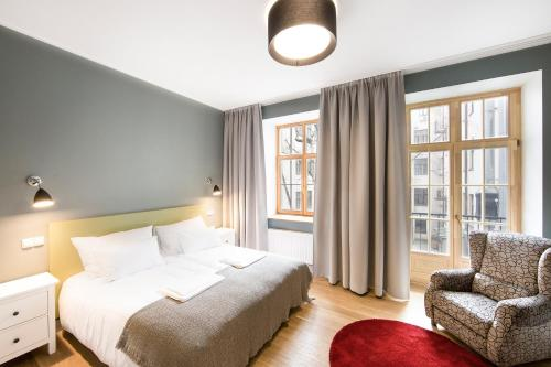 A bed or beds in a room at Riga Lux Apartments - Skolas