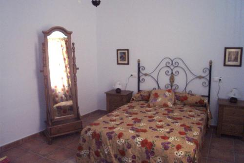 A bed or beds in a room at Casa Rural Victor