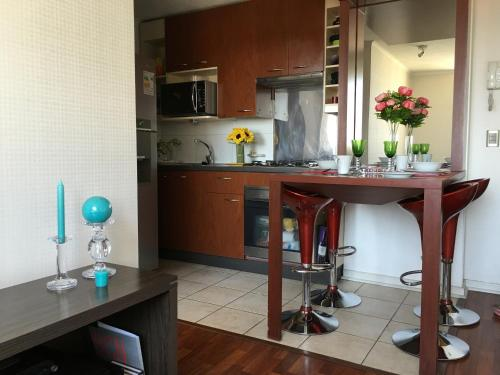 A kitchen or kitchenette at Glam Bellas Artes
